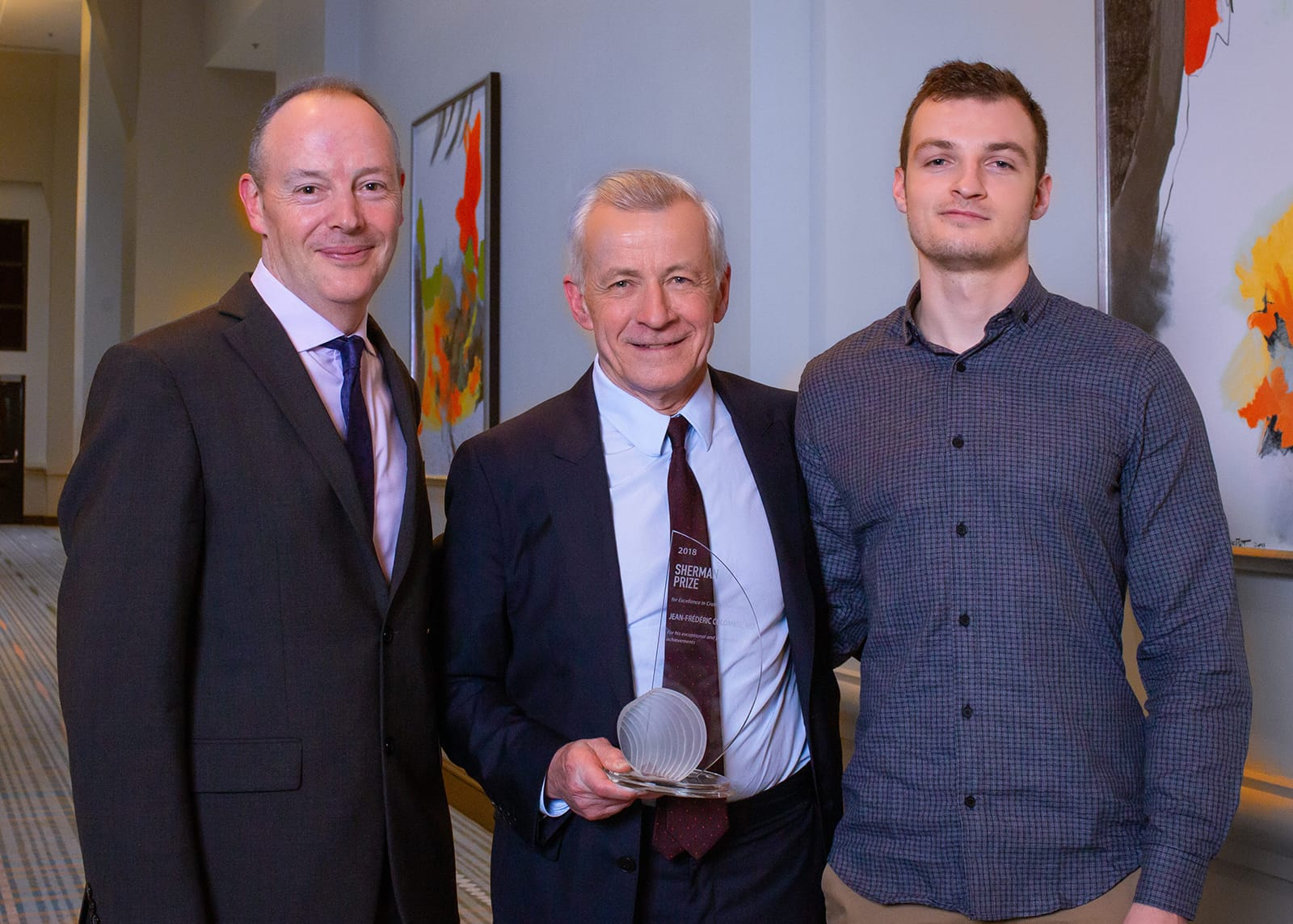 <p>Dr. Dermot McGovern and Dr. Jean-Frederic Colombel with his son</p>